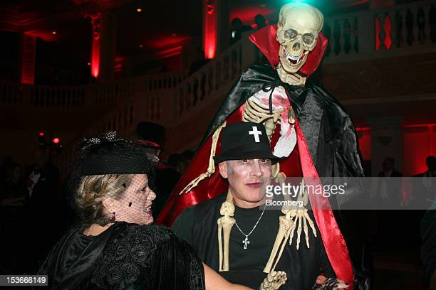 Artist and graphic designer Andres Tremols right balances a skeleton on his shoulders on the dance floor during the Washington Ballet's Dracula...