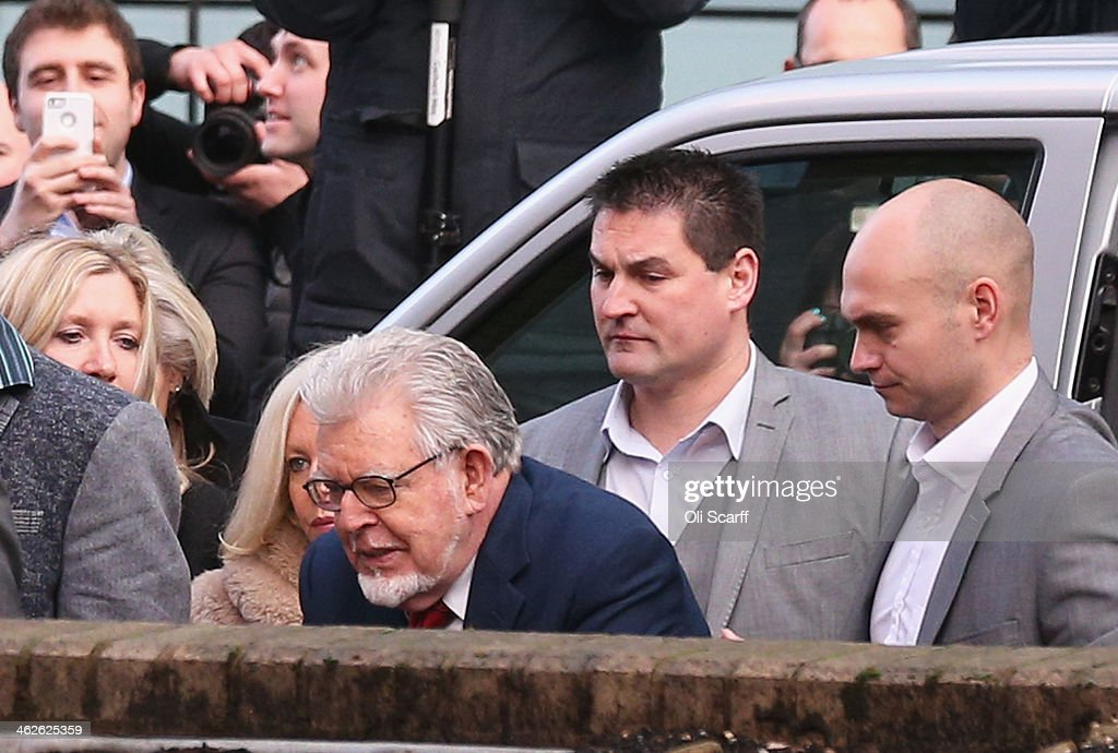Artist and television personality <a gi-track='captionPersonalityLinkClicked' href=/galleries/search?phrase=Rolf+Harris&family=editorial&specificpeople=160469 ng-click='$event.stopPropagation()'>Rolf Harris</a> (C) arrives at Southwark Crown Court on January 14, 2014 in London, England. Mr Harris, who was arrested in March 2013 by police officers working for Operation Yewtree, has been charged with 16 counts of indecent assault on teenage girls and of making indecent images of children.