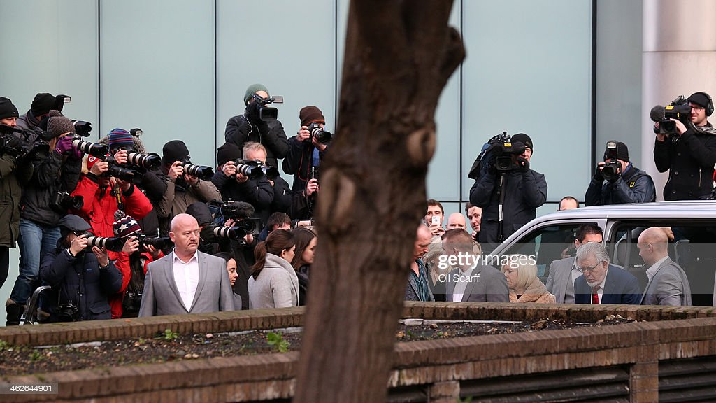 Artist and television personality <a gi-track='captionPersonalityLinkClicked' href=/galleries/search?phrase=Rolf+Harris&family=editorial&specificpeople=160469 ng-click='$event.stopPropagation()'>Rolf Harris</a> (2nd R) arrives at Southwark Crown Court on January 14, 2014 in London, England. Mr Harris, who was arrested in March 2013 by police officers working for Operation Yewtree, has been charged with 16 counts of indecent assault on teenage girls and of making indecent images of children.