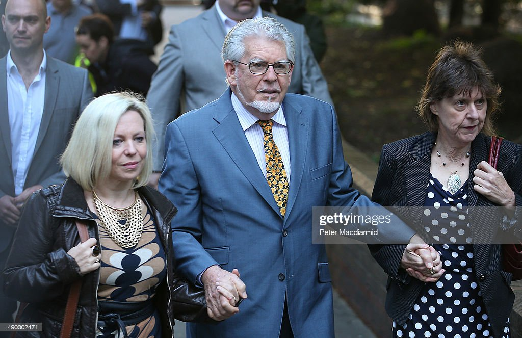 Artist and television personality <a gi-track='captionPersonalityLinkClicked' href=/galleries/search?phrase=Rolf+Harris&family=editorial&specificpeople=160469 ng-click='$event.stopPropagation()'>Rolf Harris</a> (C) arrives at Southwark Crown Court with his daughter Bindi (L) on May 14, 2014 in London, England. Mr Harris, who was arrested in March 2013 by police officers working for Operation Yewtree, denies 12 charges of indecent assault against four girls.