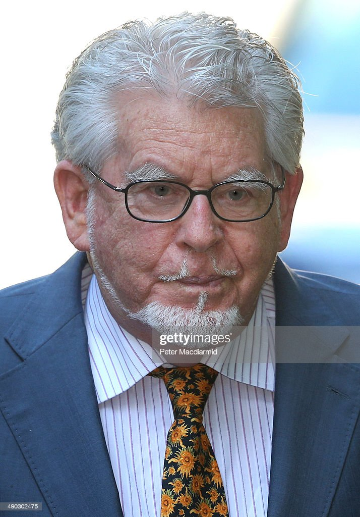 Artist and television personality <a gi-track='captionPersonalityLinkClicked' href=/galleries/search?phrase=Rolf+Harris&family=editorial&specificpeople=160469 ng-click='$event.stopPropagation()'>Rolf Harris</a> arrives at Southwark Crown Court on May 14, 2014 in London, England. Mr Harris, who was arrested in March 2013 by police officers working for Operation Yewtree, denies 12 charges of indecent assault against four girls.