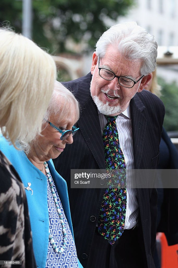 Artist and television personality Rolf Harris arrives at Westminster Magistrates' Court with his wife Alwen Hughes on September 23 2013 in London...
