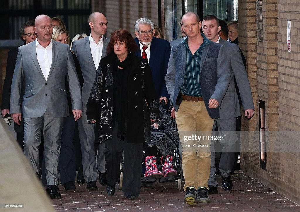 Artist and television personality <a gi-track='captionPersonalityLinkClicked' href=/galleries/search?phrase=Rolf+Harris&family=editorial&specificpeople=160469 ng-click='$event.stopPropagation()'>Rolf Harris</a> leaves Southwark Crown Court with family and friends on January 14, 2014 in London, England. Mr Harris, who was arrested in March 2013 by police officers working for Operation Yewtree, has been charged with 16 counts of indecent assault on teenage girls and of making indecent images of children. Mr Harris today pleaded not guilty to 12 counts of sexual assault.