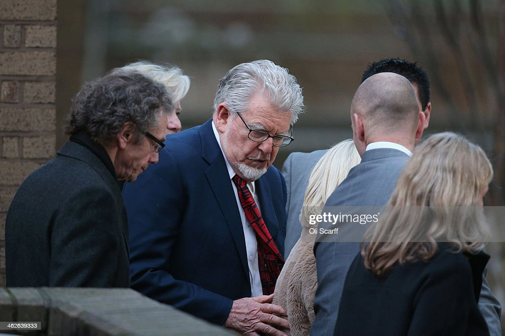 Artist and television personality <a gi-track='captionPersonalityLinkClicked' href=/galleries/search?phrase=Rolf+Harris&family=editorial&specificpeople=160469 ng-click='$event.stopPropagation()'>Rolf Harris</a> leaves Southwark Crown Court on January 14, 2014 in London, England. Mr Harris, who was arrested in March 2013 by police officers working for Operation Yewtree, has been charged with 16 counts of indecent assault on teenage girls and of making indecent images of children.