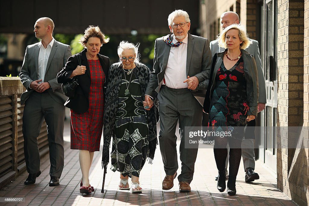 Artist and television personality <a gi-track='captionPersonalityLinkClicked' href=/galleries/search?phrase=Rolf+Harris&family=editorial&specificpeople=160469 ng-click='$event.stopPropagation()'>Rolf Harris</a> leaves Southwark Crown Court with his wife Alwen Hughes (his right) and daughter Bindi (his left) on May 9, 2014 in London, England. Mr Harris, who was arrested in March 2013 by police officers working for Operation Yewtree, denies 12 charges of indecent assault against four girls.