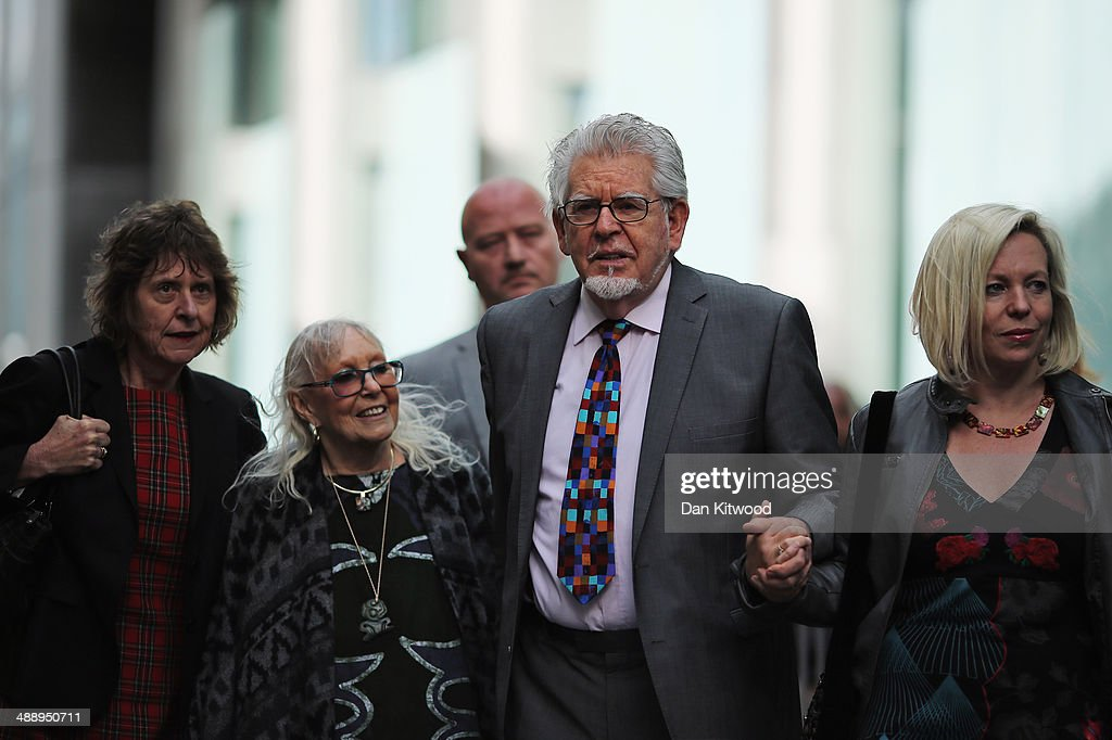 Artist and television personality Rolf Harris leaves Southwark Crown Court with his wife Alwen Hughes (his right) and daughter Bindi (left) on May 9, 2014 in London, England. Mr Harris, who was arrested in March 2013 by police officers working for Operation Yewtree, denies 12 charges of indecent assault against four girls.