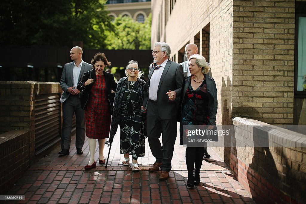 Artist and television personality Rolf Harris leaves Southwark Crown Court with his wife Alwen Hughes (his right) and daughter Bindi (his left) on May 9, 2014 in London, England. Mr Harris, who was arrested in March 2013 by police officers working for Operation Yewtree, denies 12 charges of indecent assault against four girls.