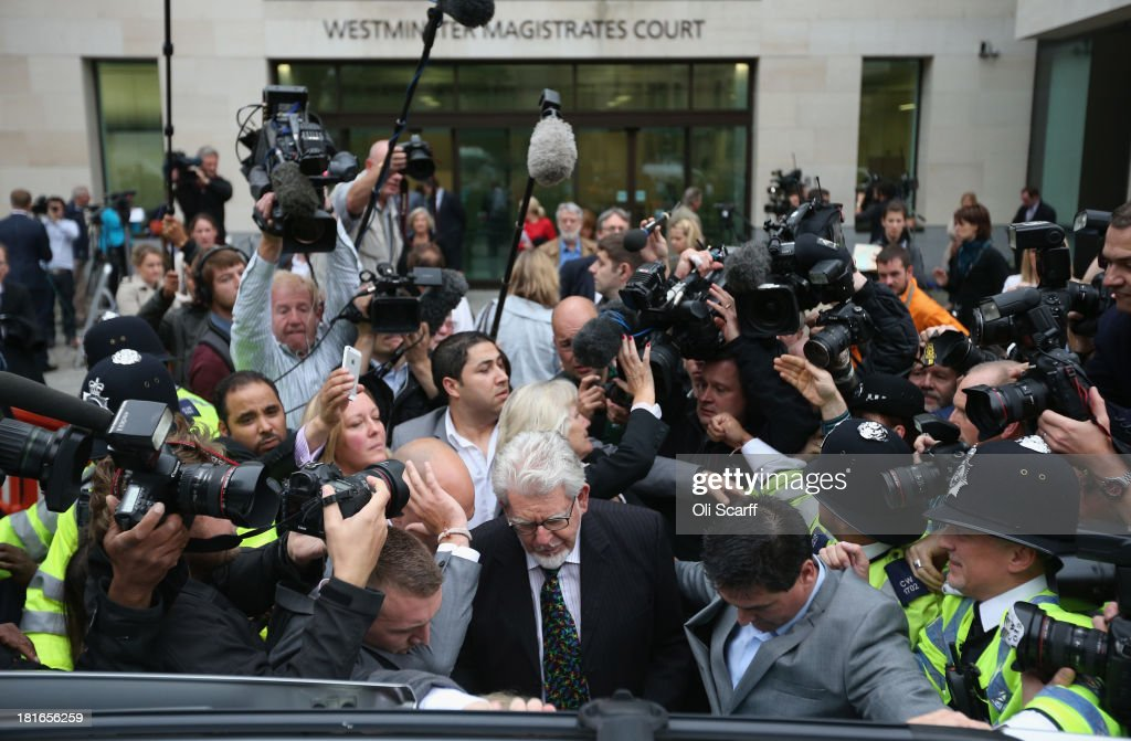 Artist and television personality Rolf Harris leaves Westminster Magistrates' Court on September 23 2013 in London England Mr Harris who was arrested...