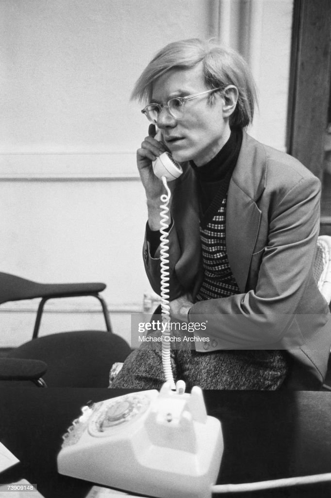 Artist Andy Warhol chats on the phone in 1972 in New York City, New York.