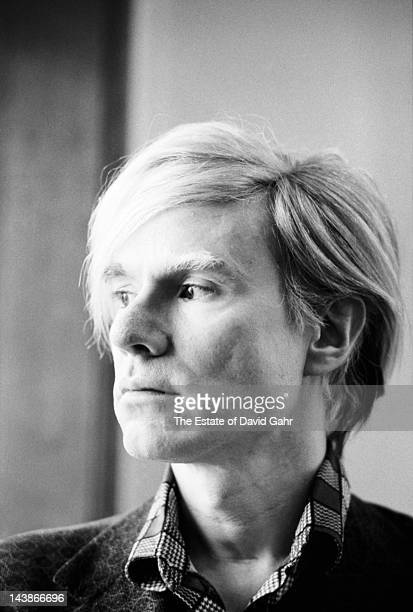 Artist Andy Warhol poses for a portrait at his studio and business offices the 'new' Factory on May 5 1971 at 33 Union Square West in New York City...