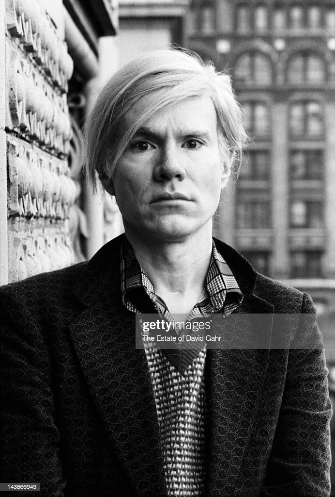 Artist <a gi-track='captionPersonalityLinkClicked' href=/galleries/search?phrase=Andy+Warhol&family=editorial&specificpeople=123830 ng-click='$event.stopPropagation()'>Andy Warhol</a> poses for a portrait on the balcony of his studio and business offices, the 'new' Factory, on May 5, 1971 at 33 Union Square West in New York City, New York.