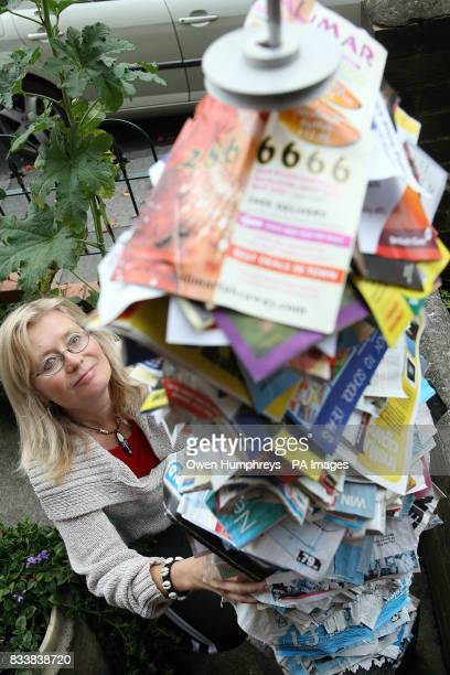 Artist Anne Cohen from Fenham Newcastle stands in her garden with a five foot tall metal spike covered in all of the junk mail that has been...