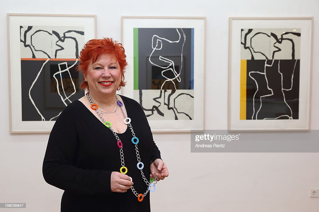 Artist Barbara Salesch poses next to her art work (title: 'Triptychon 1') at ROOT gallery on January 10, 2013 in Berlin, Germany. The exhibition will open January 10 and run through February 3.