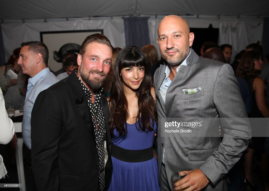 Artist Brian Bowen Smith, actress Hannah Simone, and Steph Sebbag attend the grand opening of De Re Gallery on May 15, 2014 in West Hollywood, CA.