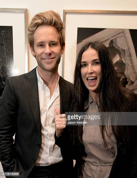 Artist Bryan Fox and actress Demi Moore attend We Alone A photography exhibit by Bryan Fox at Think Tank Gallery on May 9 2015 in Los Angeles...
