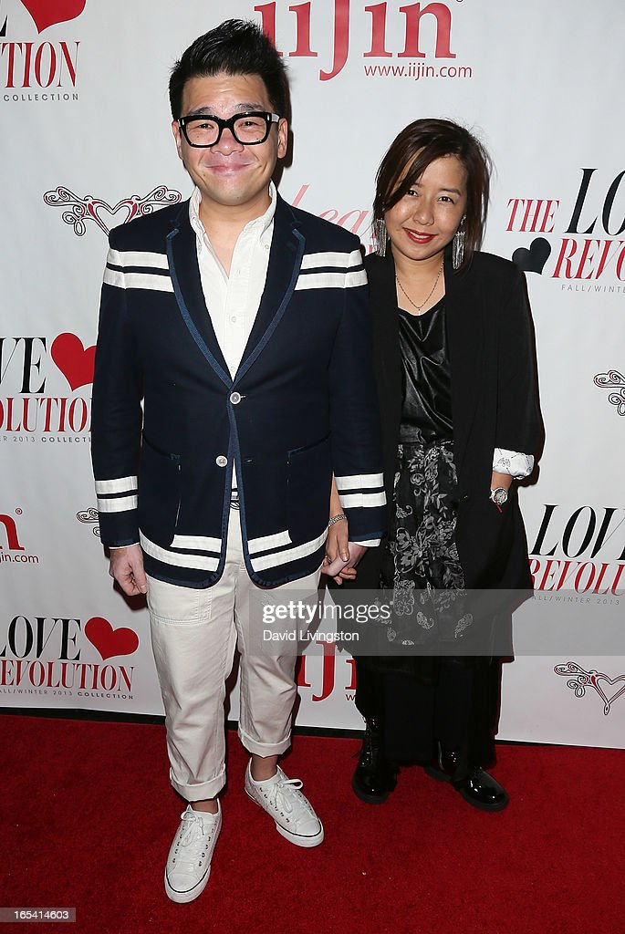 Artist Cassian Lau (L) and iiJin founder June Lee attend iiJin's Fall/Winter 2013 'The Love Revolution' fashion show at Avalon on April 3, 2013 in Hollywood, California.