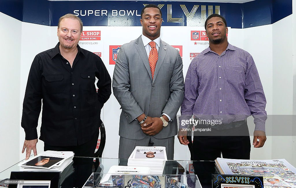 Artist Charles Fazzio, New York Jets <a gi-track='captionPersonalityLinkClicked' href=/galleries/search?phrase=Quinton+Coples&family=editorial&specificpeople=5563694 ng-click='$event.stopPropagation()'>Quinton Coples</a> and New Orleans Saints <a gi-track='captionPersonalityLinkClicked' href=/galleries/search?phrase=Kevin+Reddick&family=editorial&specificpeople=6336144 ng-click='$event.stopPropagation()'>Kevin Reddick</a> sign copies of <a gi-track='captionPersonalityLinkClicked' href=/galleries/search?phrase=Charles+Fazzino&family=editorial&specificpeople=820818 ng-click='$event.stopPropagation()'>Charles Fazzino</a>'s 'Super Bowl XLVIII - NY/NJ' Poster at Macy's Herald Square on January 27, 2014 in New York City.