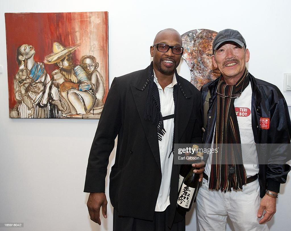 Artist Chaz Guest poses with a art lover at Quinn Studios on October 25, 2013 in Santa Monica, California.