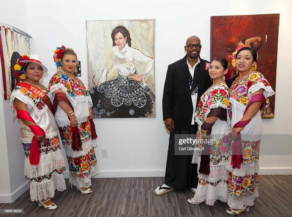 Artist Chaz Guest poses with dancers at the 'Visions Of Mexico' Artist Retrospective' at Quinn Studios on October 25, 2013 in Santa Monica, California.