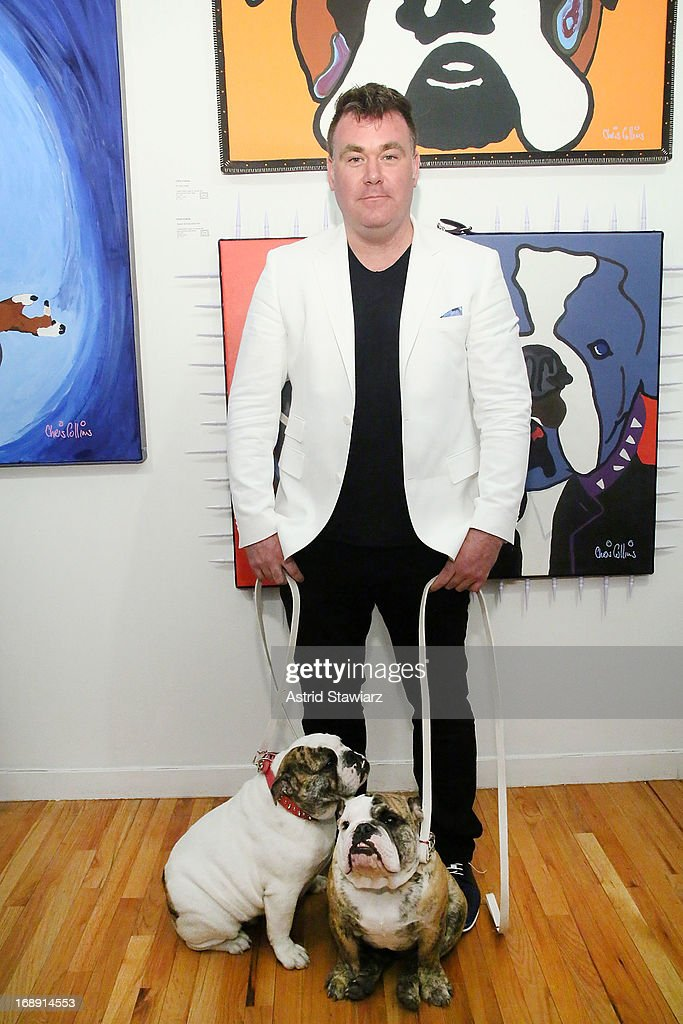 Artist Chris Collins poses for photos during the Chris Collins 'Top Dogs' VIP Reception on May 16, 2013 in New York, United States.