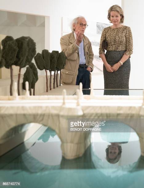 Artist Christo talks to Queen Mathilde of Belgium by a model of the 1985 Paris project 'The Pont Neuf Wrapped' during a visit of the exhibition...