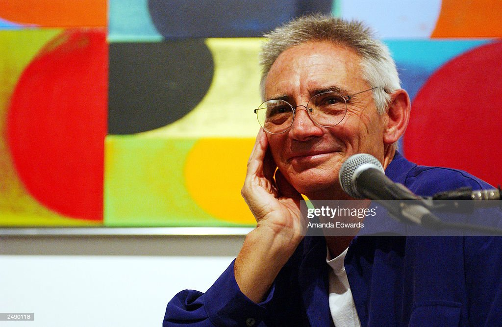 Artist Chuck Arnoldi fields questions at the Santa Monica Museum of Art's Party with Frank Gehry at Chuck Arnoldi's art studio on September 12, 2003 in Venice, California.