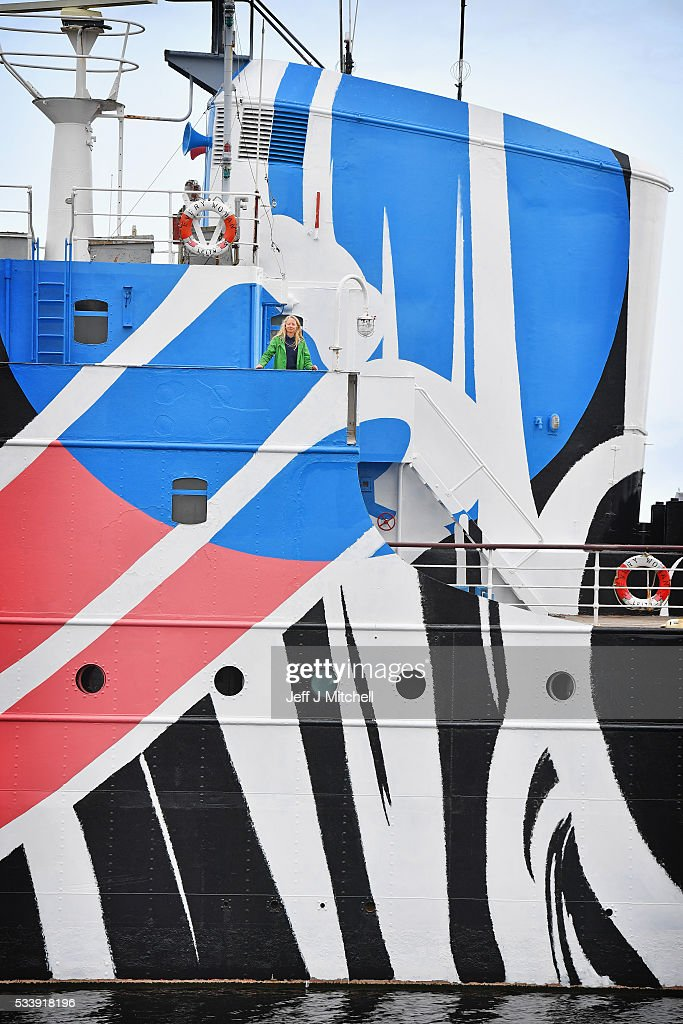 Artist Ciara Phillips poses near the first 'dazzle ship' in Scotland which she designed called 'Every Woman' and was co-commissioned by Edinburgh Art Festival and 14-18 NOW on May 24, 2016 in Edinburgh, Scotland. The first 'dazzle ship' opened in Leith to mark 100 years since the Battle of Jutland. 'Every Woman' is inspired by the huge role played by women during the First World War.