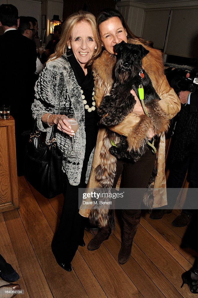 Artist Cindy Lass (R) and mother attend Dine for Dogs Trust, launching a dog friendly menu at The George Club on March 19, 2013 in London, England.