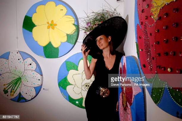 Artist Cindy Lass displays artwork featuring flowers adorned with Swarovski crystals at the VIP press preview of 'Cindy Lass An Exhibition of Her...