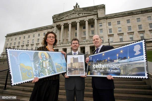 Artist Clare Melinsky Junior Minister Jeffrey Donaldson and Michael Kennedy General Manager Royal Mail Northern Ireland with three of the stamps that...