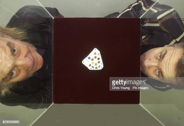 Artist Damien Hirst and Professor Colin Pillinger stand next to the Beagle 2 spot painting at the White Cube Gallery in London The painting will be...