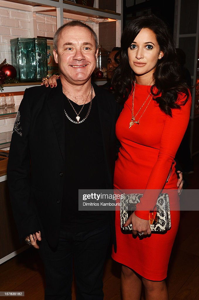 Artist Damien Hirst and Roxie Nafousi attend the Aby Rosen & Samantha Boardman dinner at The Dutch on December 6, 2012 in Miami, Florida.