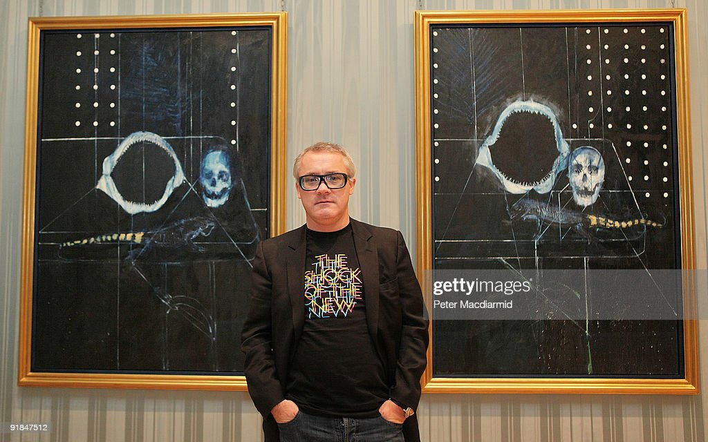 Artist <a gi-track='captionPersonalityLinkClicked' href=/galleries/search?phrase=Damien+Hirst&family=editorial&specificpeople=215142 ng-click='$event.stopPropagation()'>Damien Hirst</a> stands in The Wallace Collection at his 'No Love Lost, Blue Paintings by <a gi-track='captionPersonalityLinkClicked' href=/galleries/search?phrase=Damien+Hirst&family=editorial&specificpeople=215142 ng-click='$event.stopPropagation()'>Damien Hirst</a>' exhibition on October 13, 2009 in London. The collection comprised of 25 new paintings by British artist Hirst is being shown in the UK for the first time. The new works, created between 2006 and 2008 mark the artist's return to the solitary practice of painting.