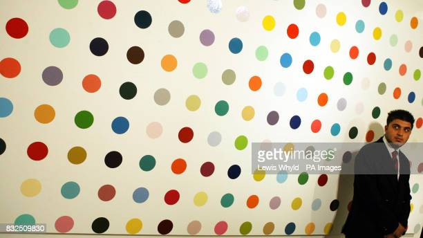 Artist Damien Hirst's Raffinose Undecaacetate painting under guard at Sotheby's It is expected to fetch 400000 to 600000 at the Whitechapel Auction...