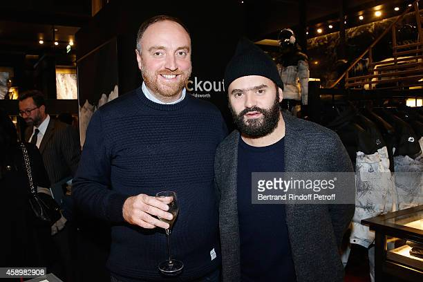 Artist Dan Holdsworth and Alexandre Mattiussi pose during a cocktail party hosted by Moncler Paris in honor of the new Moncler Blackout Collection by...