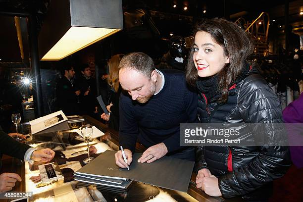 Artist Dan Holdsworth and Anouchka Delon attend a cocktail party hosted by Moncler Paris in honor of the new Moncler Blackout Collection by Dan...