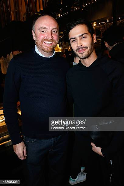 Artist Dan Holdsworth and Jesse Remond Lacroix attend a cocktail party hosted by Moncler Paris in honor of the new Moncler Blackout Collection by Dan...