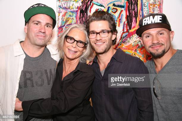 Artist Danny Minnick at his art exhibit poses with Marylin Hassett Johnny Whitworth and Fabian Alomar at Gallerie Sparta in Los Angeles California on...