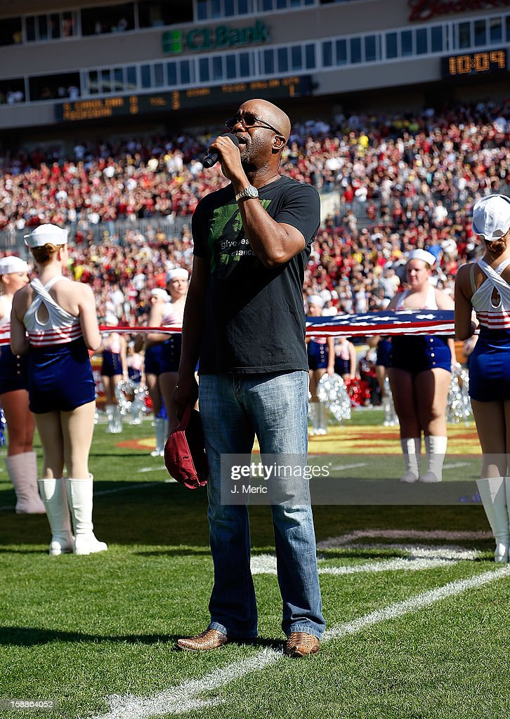 Artist Darius Rucker performs the National Anthem just before the start of the Outback Bowl between the South Carolina Gamecocks and the Michigan Wolverines at Raymond James Stadium on January 1, 2013 in Tampa, Florida.