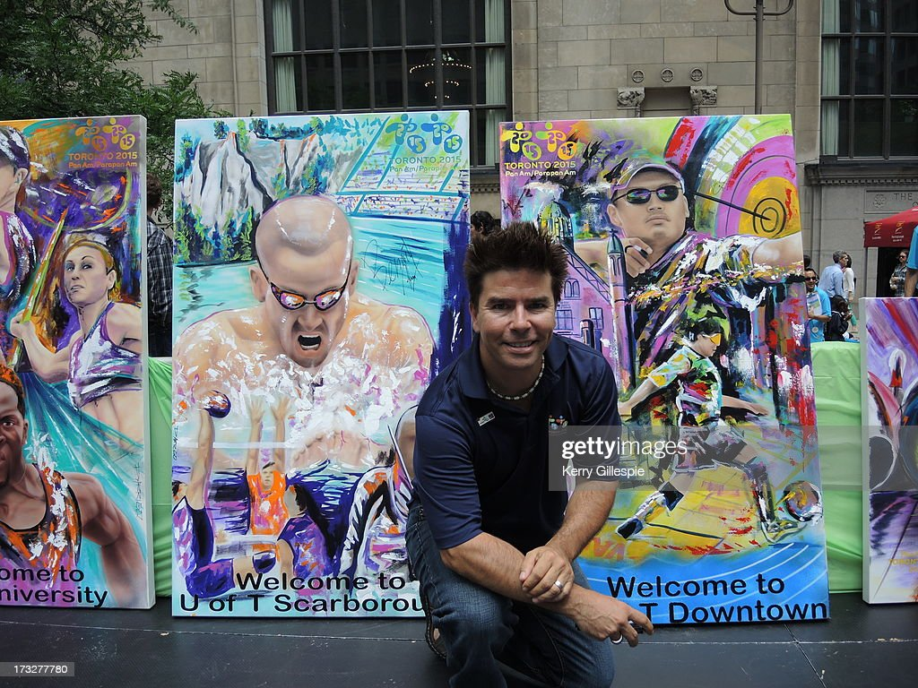 Artist David Arrigo poses with some of the 18 murals he has painted to help promote the 2015 Pan Am Games. Subject: On , at 1:24 PM, Gillespie, Kerry wrote: Artist David Arrigo has painted 18 murals to represent the sports, athletes, cultural communities and venues for the 2015 Pan Am Games. His work was on stage for the official 2-year countdown to the Games at Commerce Court in downtown Toronto on July 10, 2013. Credit: Kerry Gillespie Kerry Gillespie Sports Reporter Toronto Star Ph: 416-869-4099 Cell: 416-873-8615 kgillespie@thestar.ca dave.panam 008.jpg