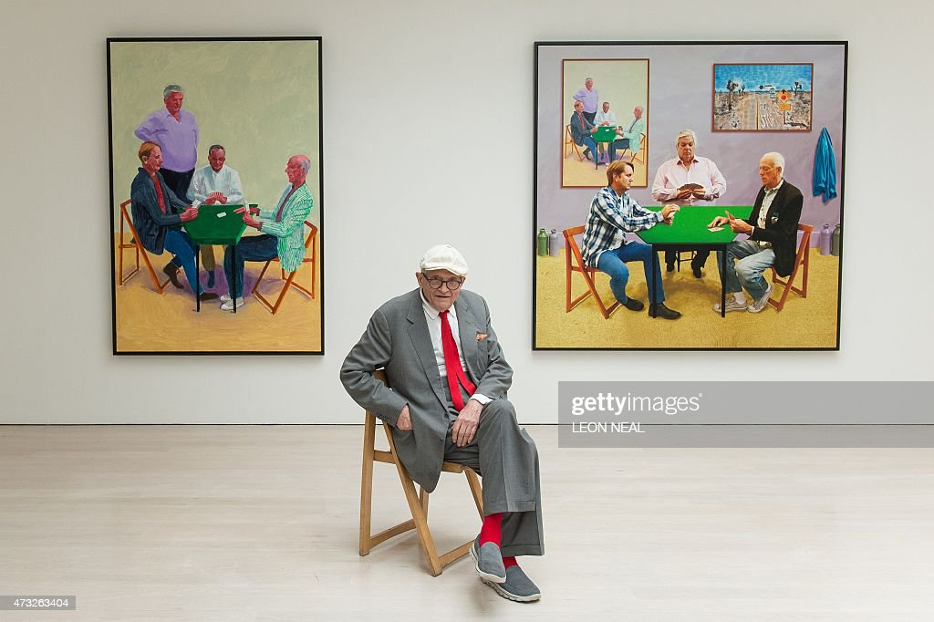 Artist David Hockney poses with his artworks 'Card Players 2014' and 'A Bigger Card Players 2015' at a press preview of his new exhibition entitled...