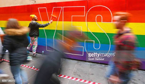 Artist David Lee Pereira paints a progay marriage mural on a wall at Melbourne Central on August 27 2017 in Melbourne Australia Artists are donating...