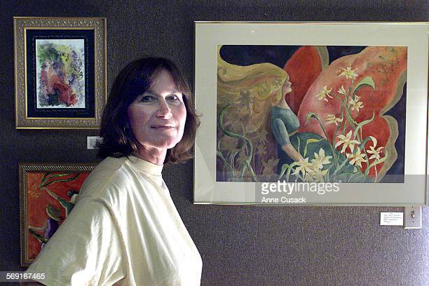 Artist Diane Severtson with some of her work on displaytop left is Oberon Anoints Tilania's Eyes a water color lower left is Celebration an acrylic...