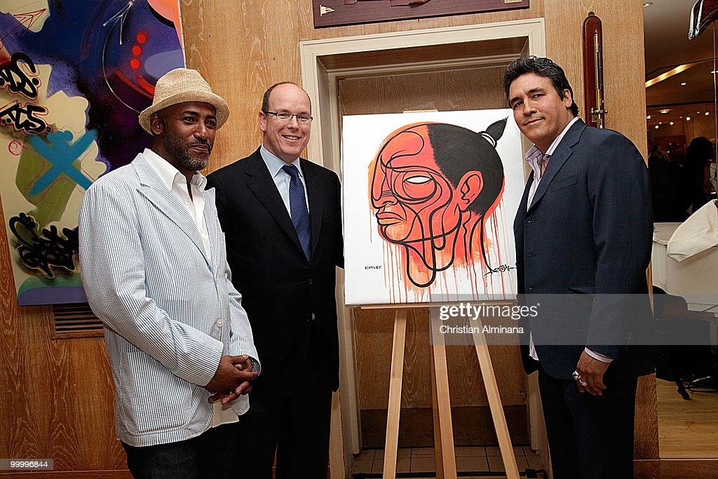 Artist Doze Green, HSH Prince Albert II of Monaco and artist Toxic attend Graffiti Au Yacht Club De Monaco, paint exhibition, on May 19, 2010 in Monaco, Monaco.