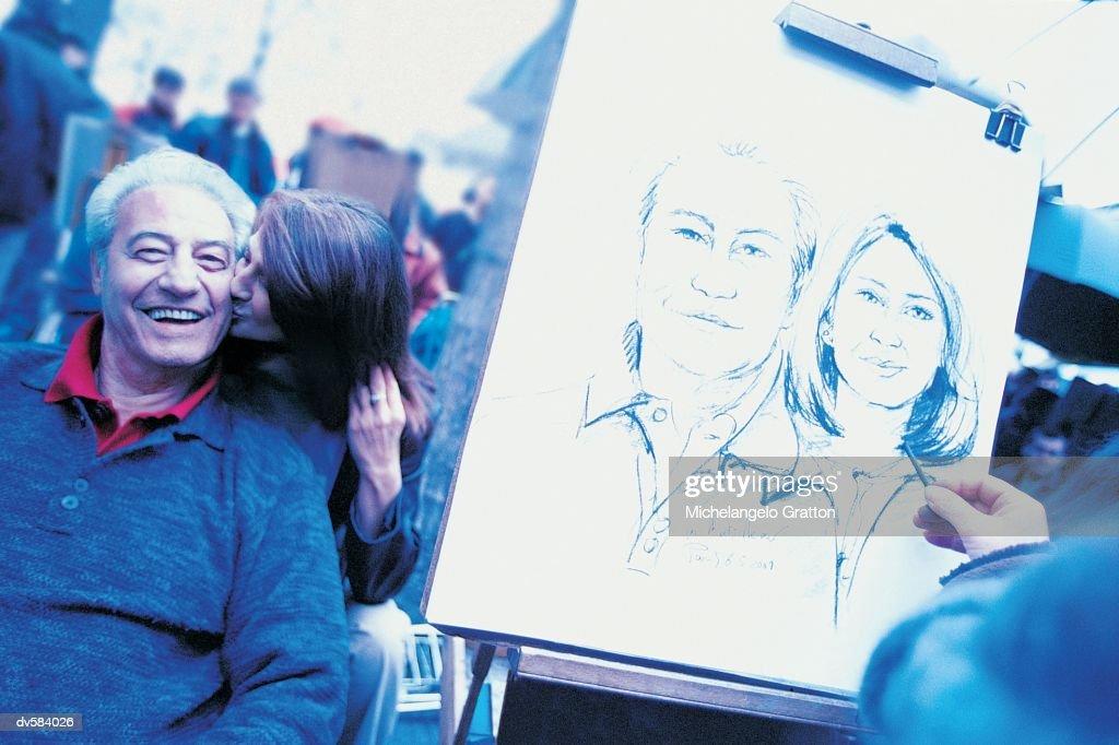 Artist drawing couple, Montmartre, Paris, France : Stock Photo