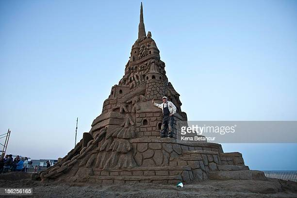 Artist Ed Jarrett poses for a picture after he set the Guinness World Record for tallest sand castle on October 29 2013 in Point Pleasant New Jersey...
