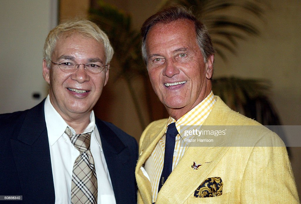 Artist Edmond Arredondo (L) poses with singer Pat Boone at the VIP luncheon to celebrate the 50th Anniversary of Solters & Digney Public Relations, and its founder Lee Solters, held on May 19, 2004 at the Beverly Hilton Hotel in Beverly Hills, California.