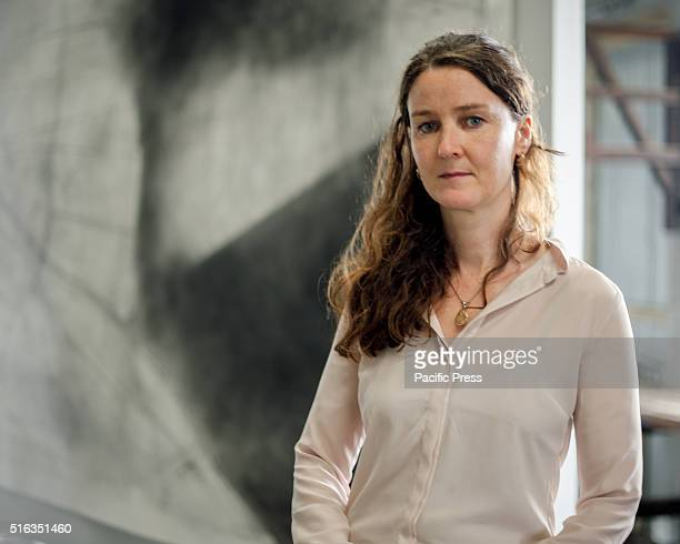 Artist Emma McNally poses with her artwork in the Ship Design Precinct during the media preview for Biennale of Sydney at Cockatoo Island The 20th...