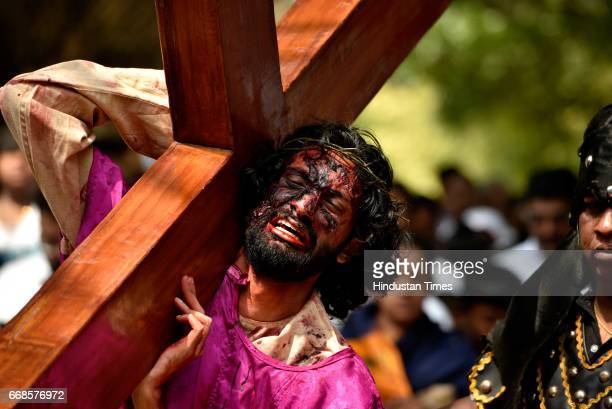 Artist enacts the crucifixion of Jesus on the occasion of Good Friday at Our Lady Lourdes Church at Cambridge Layout on April 14 2017 in Bengaluru...
