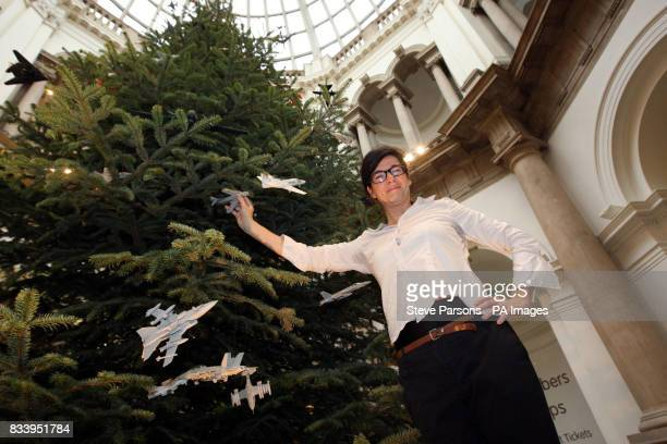 Artist Fiona Banner with her Christmas tree at the Tate Britain in central London